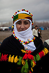VAN, TURKEY: Turkish Kurdish woman celebrates Newroz in Van, Turkey...Every year on March 21st, Kurds celebrate Newroz, the Kurdish new year. On March 21, 2013, Abudullah Ocalan, the imprisoned leader of the Kurdish separatist group, the PKK, called for his fighters to lay down their arms and retreat to northern Iraq...Photo by Refik Tekin/Metrography