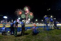 Three-wide traffic in the banking at night, Rolex 24 at Daytona, Daytona International Speedway, Daytona Beach, FL, January 2014.  (Photo by Brian Cleary/www.bcpix.com)