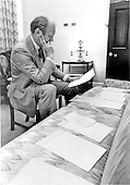 United States President Gerald R. Ford, in his private office, examines documents related to potential Vice Presidential nominees at the White House in Washington, D.C. on August 15,  1974.  Ford succeeded President Richard M. Nixon on August 9, 1974 and must nominate a new person to replace himself to serve as Vice President.<br /> Mandatory Credit: David Hume Kennerly / White House via CNP