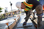 Workers prepare sidewalk fixes on San Antonio Road in downtown Los Altos.