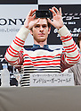 "June 13, 2012, Tokyo, Japan - Actor Andrew Garfield takes a photo of the audience with his Apple iPhone during the press conference for the film ""The Amazing Spider-Man."" The movie will be released in Japanese theaters on June 30, 2012. (Photo by Christopher Jue/Nippon News)"