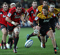 Crusaders' Samuel Whitelock races against Chiefs' Tawera Kerr-Barlow for the ball in a Super Rugby match, Waikato Stadium, Hamilton, New Zealand, Friday, July 06, 2012.  Credit:SNPA / David Rowland