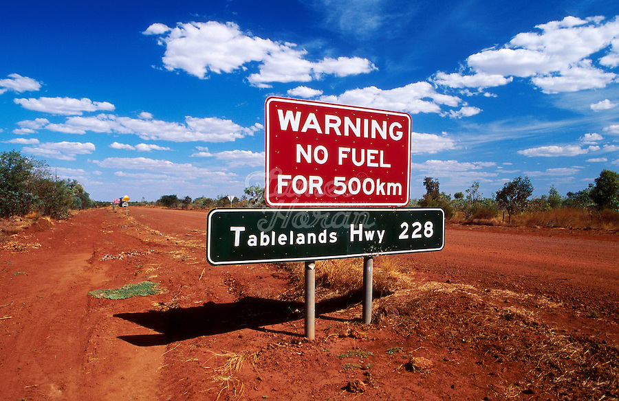 "A road sign warning ""no FUEL FOR 500KM"" on the Tablelands highway, Northern Territory , Australia"