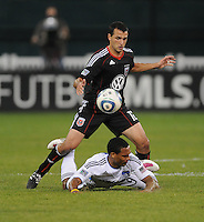 DC United defender Jed Zayner (12) fouls San Jose Earthquakes forward Scott Sealy (9).  San Jose Earthquakes defeated DC United 2-0 at RFK Stadium, October 9, 2010.