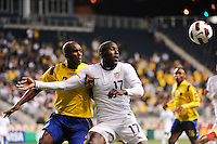 Jozy Altidore (17) of the United States (USA) holds off Aquivaldo Mosquera (2) of Colombia (COL). The men's national teams of the United States (USA) and Colombia (COL) played to a 0-0 tie during an international friendly at PPL Park in Chester, PA, on October 12, 2010.