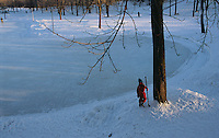 Winter brings out young boy in Montreal's Mount Royal Park for hocky on the frozen pond.
