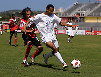 Cesar Yearwood (3) of Honduras tries to keep the ball away from Keven Aleman (10) of Canada during the group stage of the CONCACAF Men's Under 17 Championship at Catherine Hall Stadium in Montego Bay, Jamaica. Canada tied Honduras, 0-0.