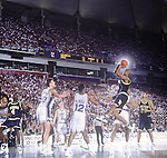 06 APR 1992:  Jalen Rose (5) of Michigan shoots a jumper over Antonio Lang (21 of Duke during the Men's Final Four Championship held in Minneapolis, MN at the Humphrey Metrodome.  Duke defeated Michigan 71-51 to win the national title.  Photo Copyright Rich Clarkson