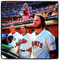 SAN FRANCISCO, CA - AUGUST 12: Instagram of Tim Flannery, Ryan Theriot, and Brandon Crawford of San Francisco Giants standing in the dugout for God Bless America during the game against the Colorado Rockies at AT&T Park on August 12, 2012 in San Francisco, California. Photo by Brad Mangin