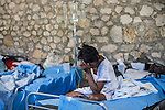 A cholera patient sits in her bed at the Hospital Albert Schweitzer on Friday, October 29, 2010 in Deschapelles, Haiti.