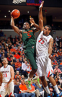 CHARLOTTESVILLE, VA- JANUARY 7: DeQuan Jones #5 of the Miami Hurricanes shoots next to Mike Scott #23 of the Virginia Cavaliers during the game on January 7, 2012 at the John Paul Jones Arena in Charlottesville, Virginia. Virginia defeated Miami 52-51. (Photo by Andrew Shurtleff/Getty Images) *** Local Caption *** Mike Scott;DeQuan Jones