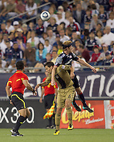 Philadelphia Union midfielder Stefani Miglioranzi (6) and New England Revolution midfielder Pat Phelan (28) battle for head ball. The Philadelphia Union defeated New England Revolution, 2-1, at Gillette Stadium on August 28, 2010.