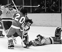 Seals Bert Marshall and Ted McAneeley hold off Detroits Mickey Redmond while golie Gilles Meloche freezes the puck. (photo/Ron Riesterer)