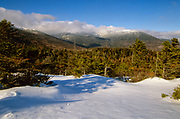 Scenic view of the Presidential Range from Low's Bald Spot in the White Mountains of New Hampshire during the winter months. This view point is located just off the Appalachian Trail (Madison Gulf Trail).