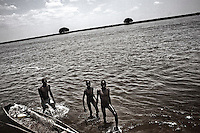 South Sudan. 25 March 2011...Young Medari fishermen on Nile, near Terekeka..