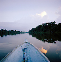 A canoe glides through rainforest at the Tortuguero National Park, East Coast, Tortuguera, Limon, Costa Rica