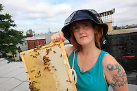 "Megan Paska, 29 years old, from Brooklyn. She started beekeeping in January.  ""I come from Baltimore in Maryland but my family is from the country and during my childhood we had a garden. For me, who came to New York recently, it is also a way of meeting people with different interests. I am fascinated. I open my hive every week, watching the bees is for me like meditation, a way to relax. I work for a company that makes children's clothing""."