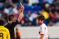 Juninho (8) of the New York Red Bulls receives a yellow card from referee Geoff Gamble. The New York Red Bulls and the Columbus Crew played to a 2-2 tie during a Major League Soccer (MLS) match at Red Bull Arena in Harrison, NJ, on May 26, 2013.