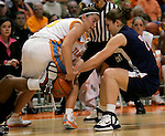 KNOXVILLE, TN--07 JANUARY 2005- 010706JS09-<br /> UConn's Mel Thomas and Tennessee's Shanna Zolman battle for a loose ball during their game Saturday at the Thompson-Boling Arena in Knoxville, Tennessee. <br />  --Jim Shannon Republican American--UConn; Tennessee; Thompson-Boling Arena; Knoxville; Tennessee,  Mel Thomas, Shanna Zolman are CQ