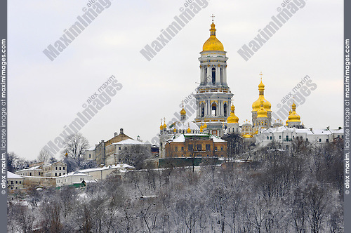 Travel stock photo of Kievo-pecherskaya lavra - Kiev pechersk lavra - Cave monastery on a snow covered hill Kiev Ukraine Eastern Europe Horizontal view from the left bank of the Dnieper river November 2007