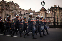 Police march past the Palacio de Gobierno on Saturday, Apr. 11, 2009 in Lima, Peru.