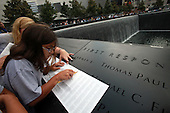 On the 10th anniversary of the September 11th attacks, Samantha Palazzo, 11, of Staten Island, traces the name of her father, Jeffrey Palazzo of the Fire Department's Rescue 5, at opening day of the September 11th Memorial at the World Trade Center site in New York, New York on September 11, 2011..Credit: Jefferson Siegel / Pool via CNP