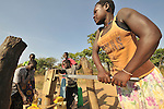 Women get water from a well in the Southern Sudan village of Kupera. Families here returned from refuge in Uganda in 2006 following the 2005 Comprehensive Peace Agreement between the north and south. The well was installed by Catholic Relief Services (CRS).