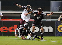 DC United midfielder Andy Najar (14) gets fouled by midfielder Jamie Smith (20) DC United tied The Colorado Rapids 1-1, at RFK Stadium, Saturday  May 14, 2011.