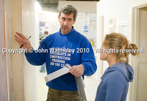 Painting & Decorating student  and an instructor discussing her next task, Able Skills, Dartford, Kent.