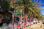Europe, Portugal Madeira. Cafes line the harbor promenade in Funchal.