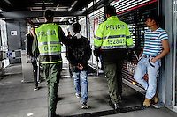 Colombian police officers detain a thieve in a station of the massive public transportation know as TRANSMILENIO in Bogota, Colombia.  05/15/2015. Eduardo MunozAlvarez/VIEWpress