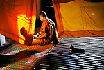 A monk studies Buddhist scripture in the late afternoon at a monastery in Aranyaprathet, Thailand, 1996, 1998<br />