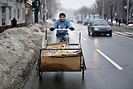 Admir Obilit, a Roma man, collects cardboard and other recyclable material in his peddle-driven cart in Belgrade, Serbia. Many Roma came to Belgrade as refugees from Kosovo. Lacking legal status in Serbia, many have difficulty obtaining formal employment and accessing government services. Recycling is a common means for Roma to earn income.