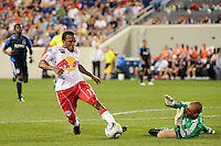 Dane Richards (19) of the New York Red Bulls attempts to get around San Jose Earthquakes goalkeeper Jon Busch (18). The New York Red Bulls defeated the San Jose Earthquakes 2-0 during a Major League Soccer (MLS) match at Red Bull Arena in Harrison, NJ, on August 28, 2010.