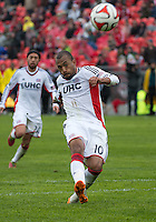 Toronto, Ontario - May 3, 2014: New England Revolution forward Teal Bunbury #10 in action during a game between the New England Revolution and Toronto FC at BMO Field.<br /> The New England Revolution won 2-1.