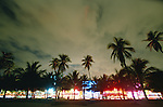 USA, Florida, Miami Beach, Art Deco District buildings illuminated at