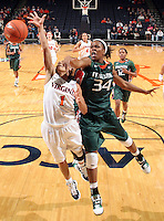 Jan. 6, 2011; Charlottesville, VA, USA; Virginia Cavaliers guard China Crosby (1) is fouled by Miami Hurricanes forward Sylvia Bullock (34) during the game at the John Paul Jones Arena. Miami won 82-73. Mandatory Credit: Andrew Shurtleff-
