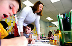 WOODBURY, CT. 04 January  2006-010405SV01--From left, Kurt Sagendorf, 7, writes about his Christmas vacation as first grade teacher Mary Ellen Kuzma helps Tyler Fengler, 6, with his journal during a writing exercise at Mitchell Elementary School in Woodbury Tuesday. The students were writing about what they did on their extended vacation.<br /> Steven Valenti Republican-American<br /> (Kurt Sagendorf, Tyler Fengler,Mary Ellen Kuzma, (cq))