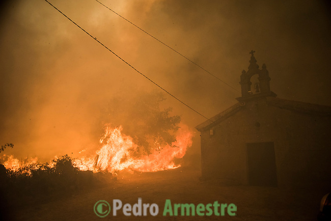 A general view shows burnt fields and forests during a wildfire in Cualedro, near Ourense on August 30, 2015. A fire broke out on August 30, 2015 around noon in the Cualedro town in Galicia, northwest Spain, affecting at least 3,180 hectares of forest, as seven fires continued to burn in Spain, three in Galicia, one in Cantabria, one in Castile and Leon, one in Catalonia and Extremadura. © Pedro ARMESTRE