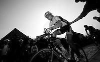 E3 Prijs Harelbeke 2012.Johan Vansummeren getting a little push up the Paterberg