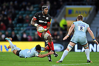 Maro Itoje of Saracens takes on the Worcester Warriors defence. Aviva Premiership match, between Saracens and Worcester Warriors on November 28, 2015 at Twickenham Stadium in London, England. Photo by: Patrick Khachfe / JMP