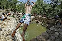 Israelis are enjoying the cool water during the hot weekend in the Sataf near Jerusalem. June 1 2013. Photo by Oren Nahshon