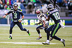 Seattle Seahawks Russell Wilson watches his pass to wide receiver Paul Richardson (10) as St. Louis Rams defensive back Lamarcus Joyner (20) defends  during the second quarter  at CenturyLink Field in Seattle, Washington on December 28, 2014. The Seahawks officially wrapped up the No. 1 seed in the NFC playoffs shortly after beating the Rams, 20-6. Despite the Cowboys and Packers also winning to finish 12-4, the Seahawks (12-4) won the multi-team tiebreaker and earned home-field advantage throughout the playoffs for the second consecutive season.  ©2014. Jim Bryant Photo. All Rights Reserved.