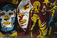 Grafitti on the streets of  Mexico City depict a scene of two of Lucha  Libre's legends: Blue Demon and El Santo.