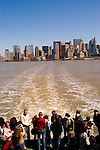 New York City, New York: Ferry from Castle Clinton to Statue of Liberty and Ellis Island, showing skyline of New York lower manhattan post 9-11.  .Photo #: ny212-14810  .Photo copyright Lee Foster, www.fostertravel.com, lee@fostertravel.com, 510-549-2202.