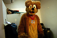 A furry calling himself J. D. Puppy waits backstage inside the Central Park bandshell during the Easter Eggstravaganza in Manhattan, New York.   Furries are a group of people who identify themselves not as being human but as a walking, talking animal.  For some the lifestyle is complete, animal traits reach into every aspect of life from mundane trips to a grocery store to sexual fantasies.  For others, involvement in the furry fandom is limited to public performances and meet-and-greets.