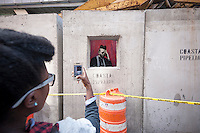 "Street art enthusiasts flock to the East Village neighborhood of  New York on Saturday, October 12, 2013 to see the twelfth installment of Banksy's graffiti art, ""Concrete confessional"". The elusive street artist is creating works around the city each day during the month of October accompanied by a satirical recorded message which you can hear by calling the number 1-800-656-4271 followed by  # and the number of artwork.  (© Richard B. Levine)"