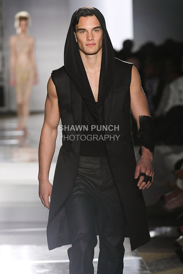 Model walks runway in an outfit by Grace Hu, for the Parsons 2011 BFA Fashion Show, hosted by Reed Krakoff.