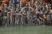 Naga Sadhus (naked saints) performing rituals before the  holy dip during the first Sahi Snan (Royal dip) at Kumbh mela on 12th February 2010. Haridwar, Uttara Khand, India, Arindam Mukherjee