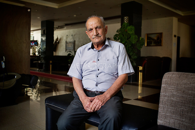 29/08/15. Shaqlawa, Iraq. -- Nouri, a 70 y.o. retired army officer, now lives at the four star hotel Basma Alsafeer, in Shaqlawa city centre. At the hotel he shares two rooms with his sons&rsquo; families: one suit for 1million IQD and a room for 700.000 IQD. His sons are all goldsmiths, but they could not find a job suitable for them, and have therefore been without a job for the past 18 months. <br /> <br /> &quot;Here we don't miss anything, but I feel like a tourist: I hope to go back home soon, I wouldn't have left if my family did not beg me to&quot;.